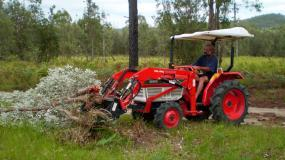 Stephen used the 4-in-1 to push over banksias and pop them out of the ground.