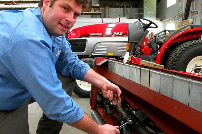 Mark Crakanthorp tightens the bolts on a flail mower.