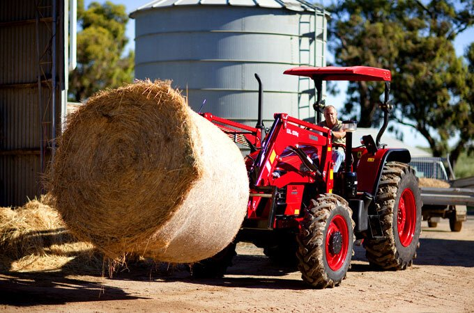 Large APOLLO tractor with bales spikes. Ideal for lifting round bales, (tractor has a SWL of 1200kg).
