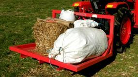 Carryalls are a handy way to transport heavy items around your farm.