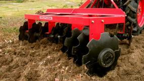 Break up soil for crop preparation with the AGMAX disc harrows.