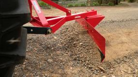 Levelling soil or preparing a path is easy with the AGMAX grader blade.