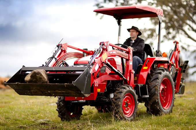 The APOLLO 354 fitted with a front end loader efficiently and safely transports rocks and dirt around your property.