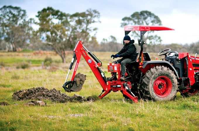The APOLLO 554 with a backhoe digs trenches with ease.