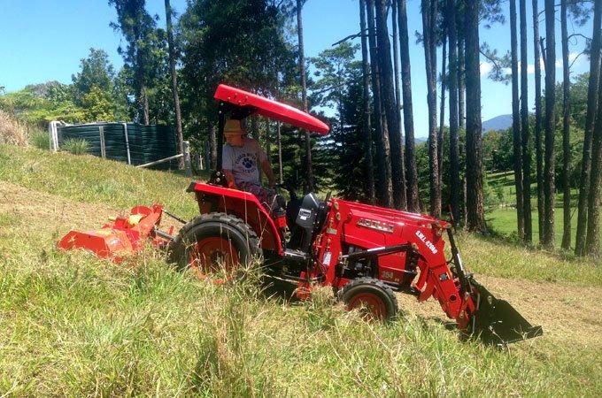 John slashing with his APOLLO 354 tractor.