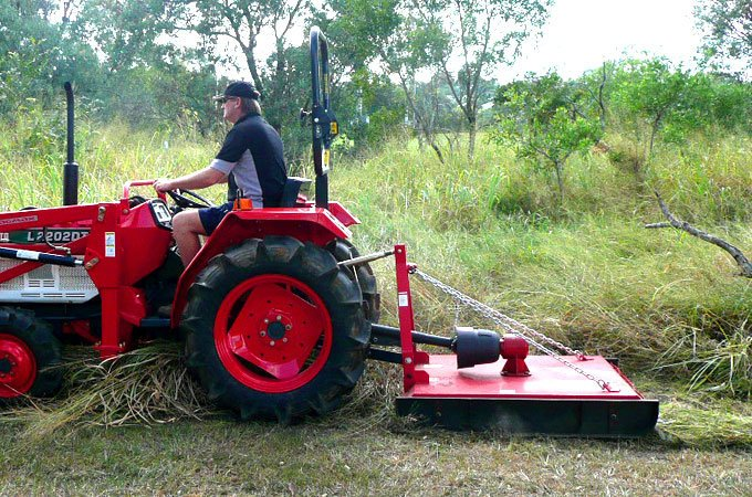 Slashing long grass with a Kubota L2202DT and AGMAX slasher is fast and effective.