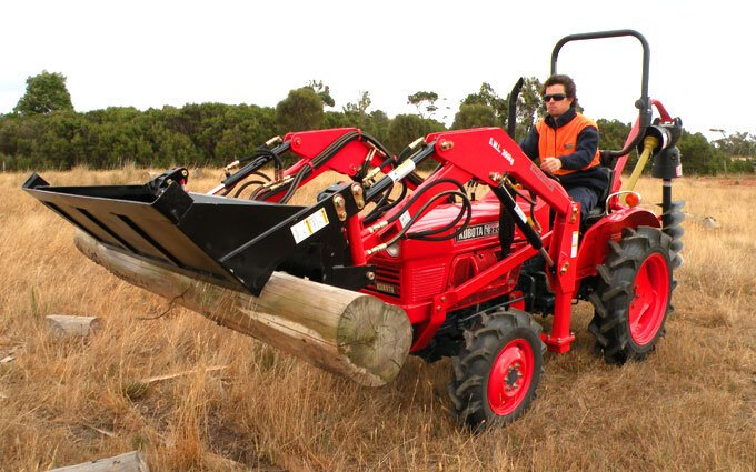 Remanufactured Kubota L2201DT with a front end loader is a versatile workhorse on small farms.