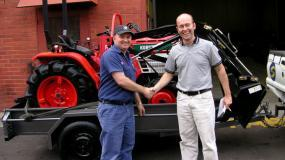 A satisfied customer with a remanufactured Kubota tractor.