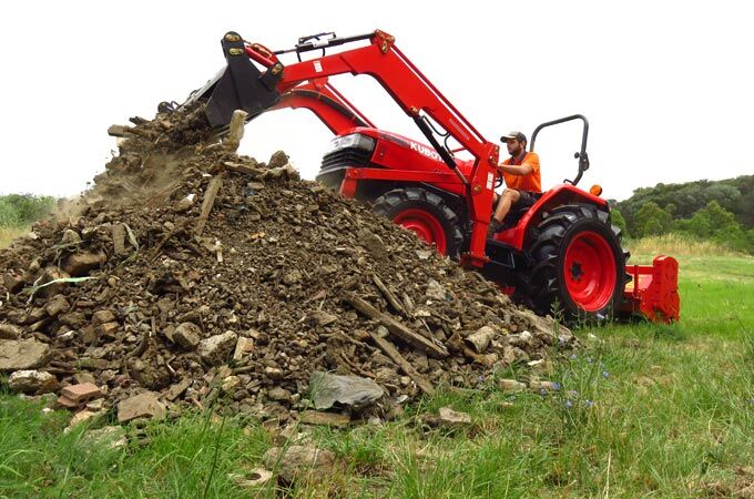 Used Kubota Tractors L4508DT with front end loader.