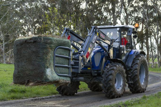 The Farmtrac 9120DTn with bale grab.
