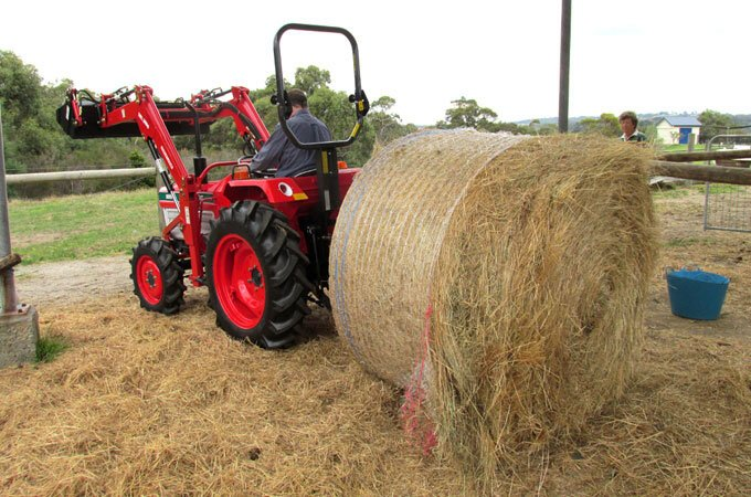 Remanufactured Kubota L2402DT with rear bale spike.