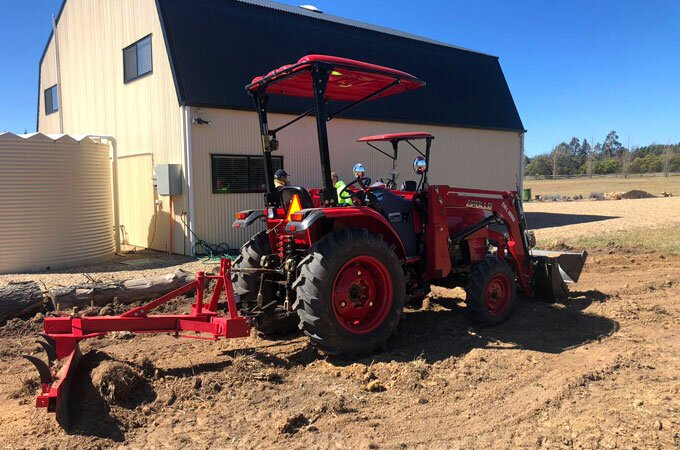 An APOLLO 454 grading with an AGMAX GB180R grader blade in NSW.