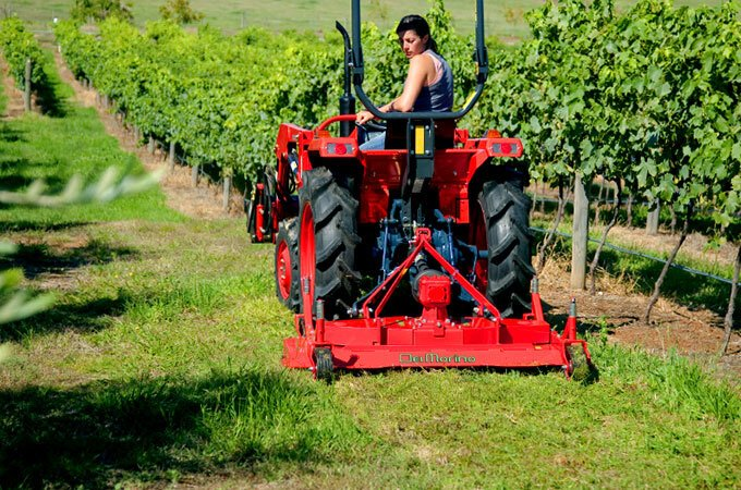 Remanufactured Kubota with finishing mower, in a vineyard application.