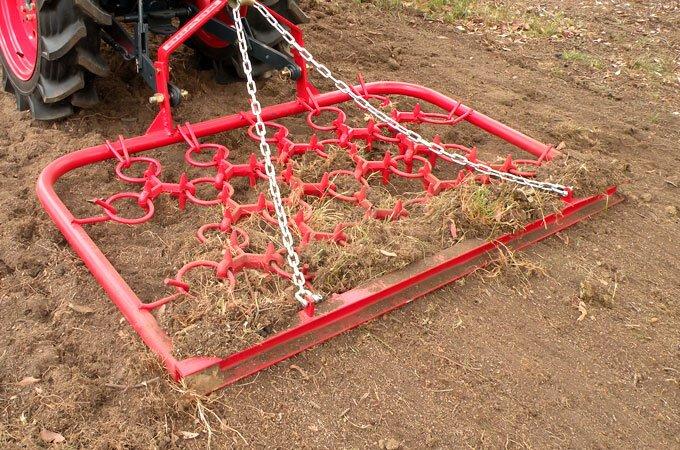 Pasture harrows redistribute soil more evenly.