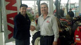 Steve Watt accepts the award from Derek Lane of PFG Australia.